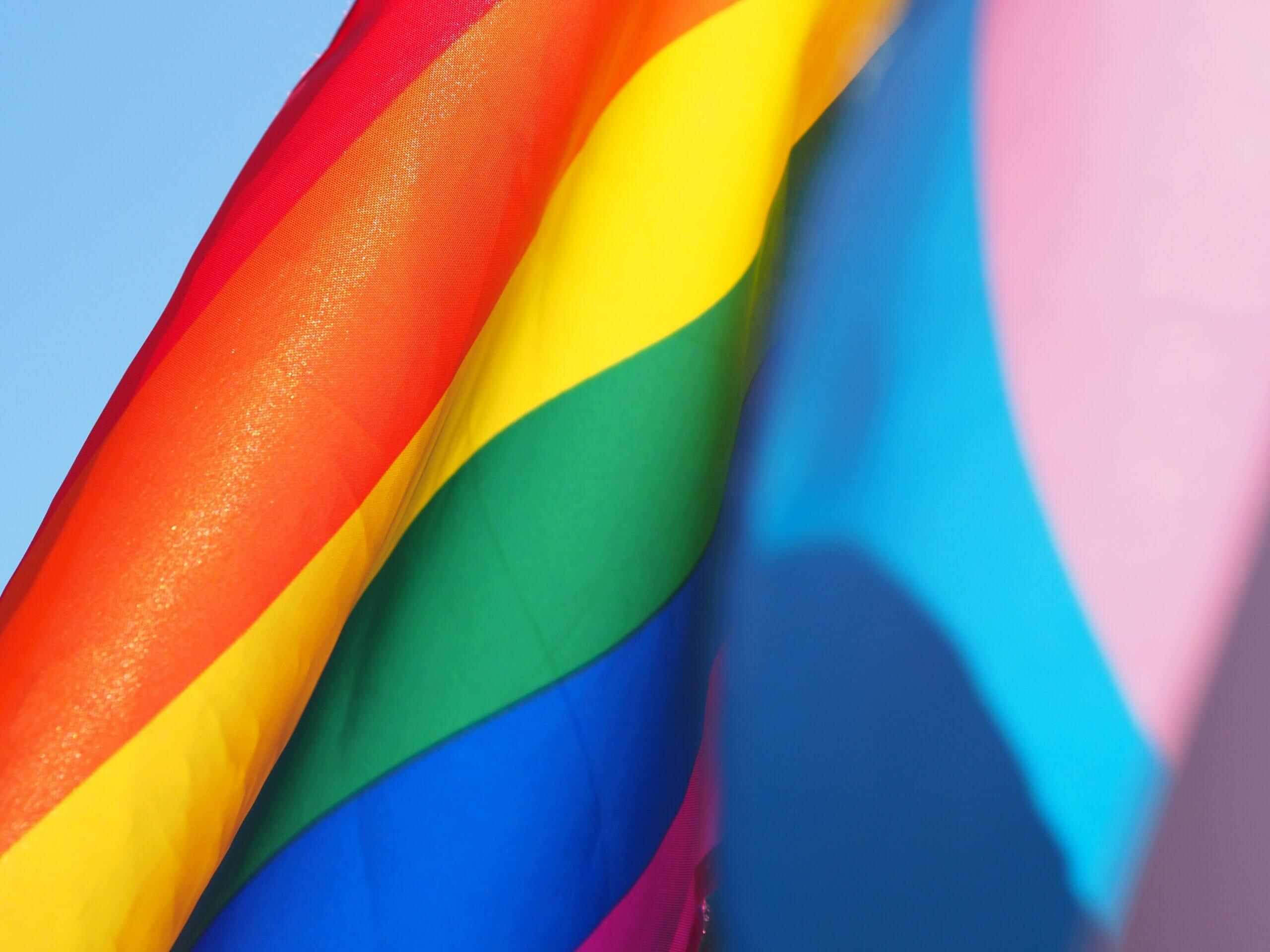 Pride flag blowing in the wind.