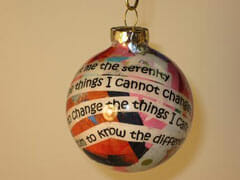 Christmas tree ornament with motivational text on it