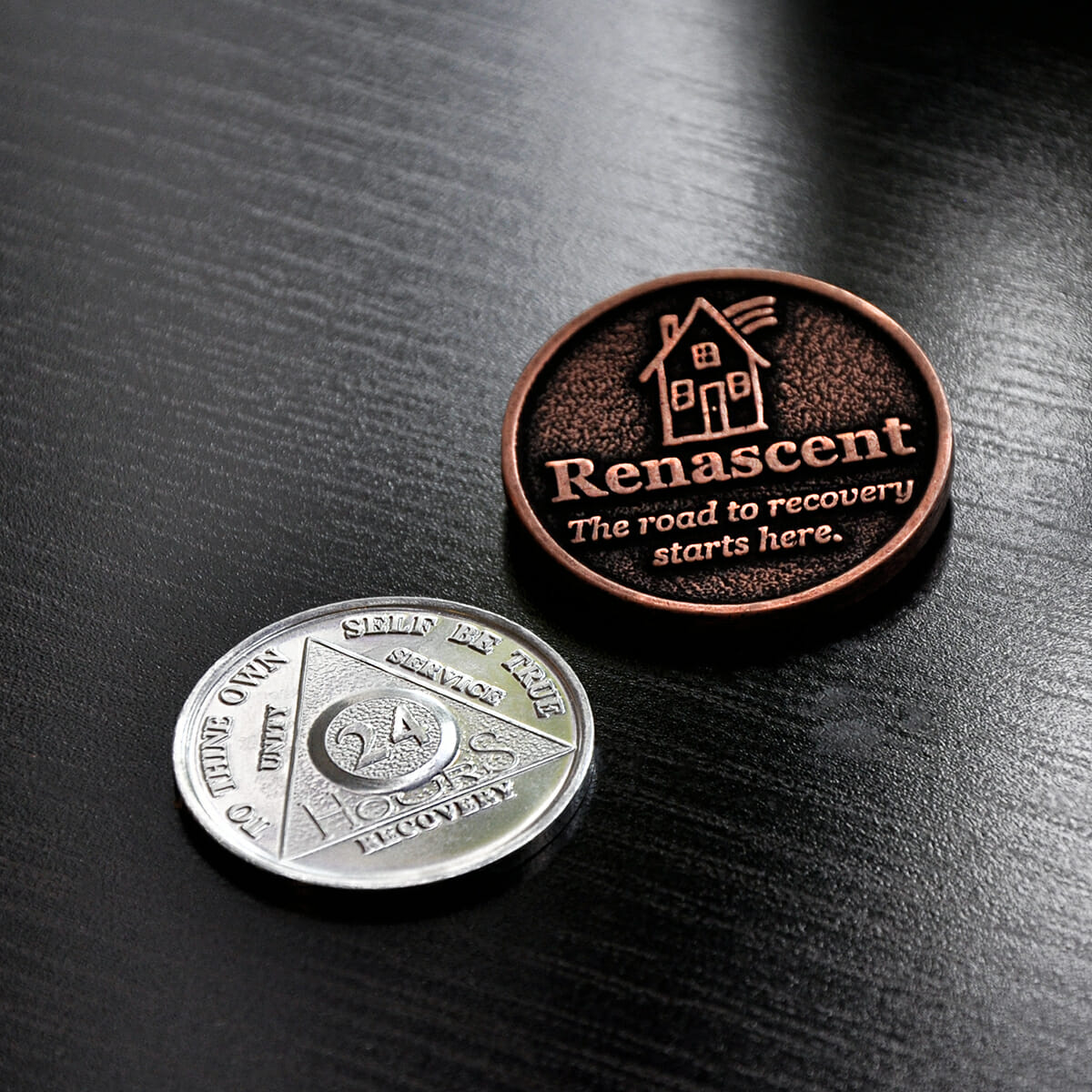 Renascent addiction recovery medallions.