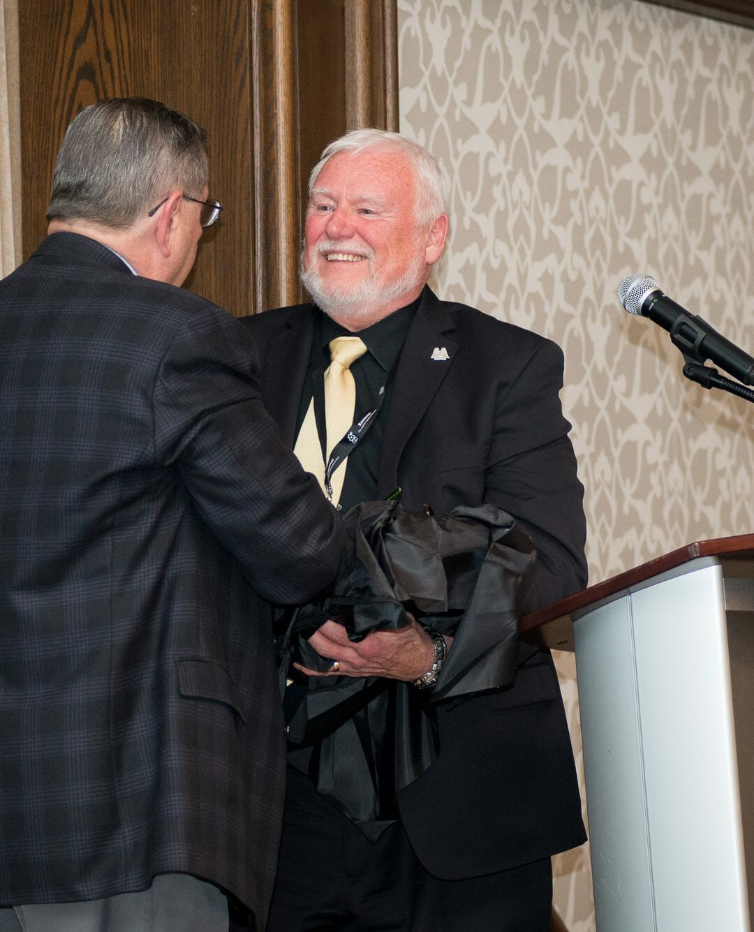 Ed Harding (left) presenting Dennis James (right) with the Ed & Bobby Yielding Award at the 2017 Guardian Angel Luncheon.