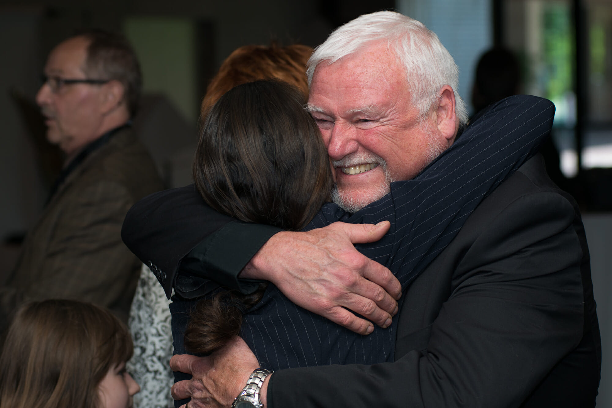 People hugging at the 2017 Guardian Angel Luncheon.
