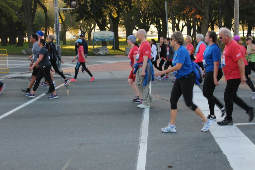 Group of people participating in the Scotiabank Waterfront Marathon.