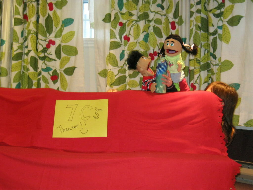 Children putting on puppet show at Renascent monthly aftercare program