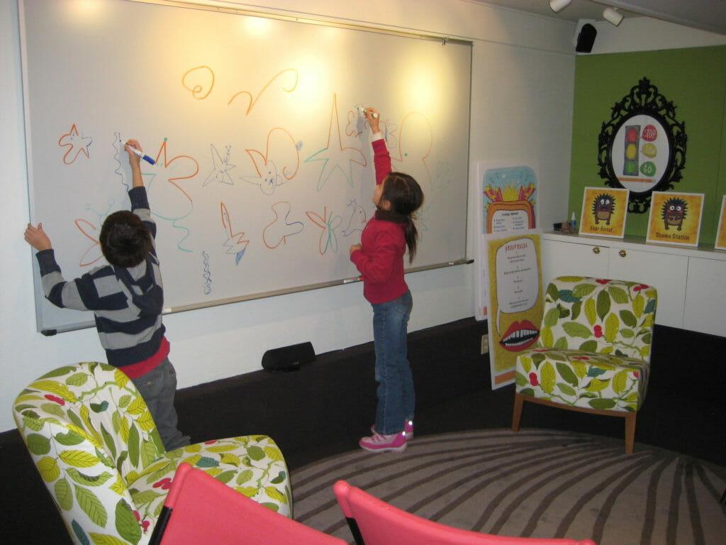 Children drawing at Renascent's intensive Children's Program for families