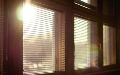 Window blinds with sun shining in