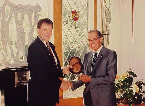Les Talbot & George Clarke shaking hands