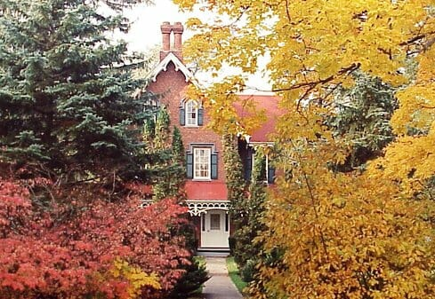 Sullivan House in Fall brick house with changing leaves in front