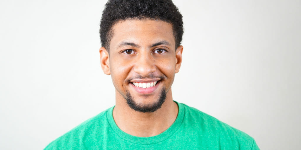 Headshot of man wearing a green tee shirt.