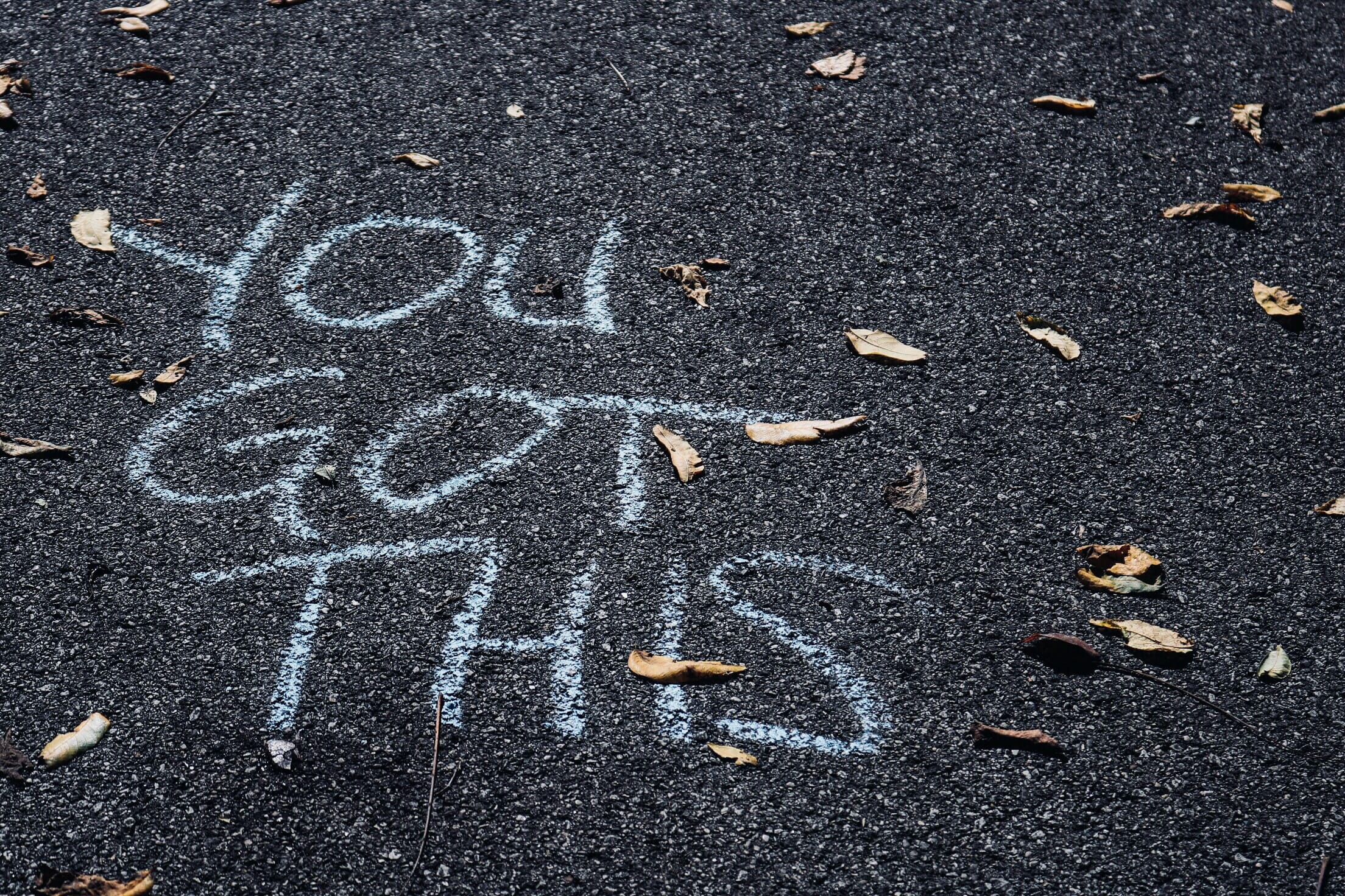 You Got This written in chalk on sidewalk.
