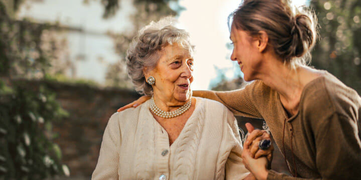 happy mother and daughter discussing family addiction counselling