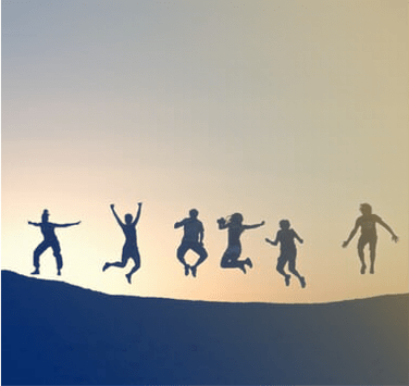 Group of people jumping in air with sunset in the background.