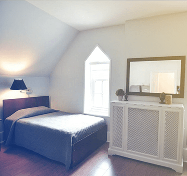 Bedroom at one of Renascent treatment centres.