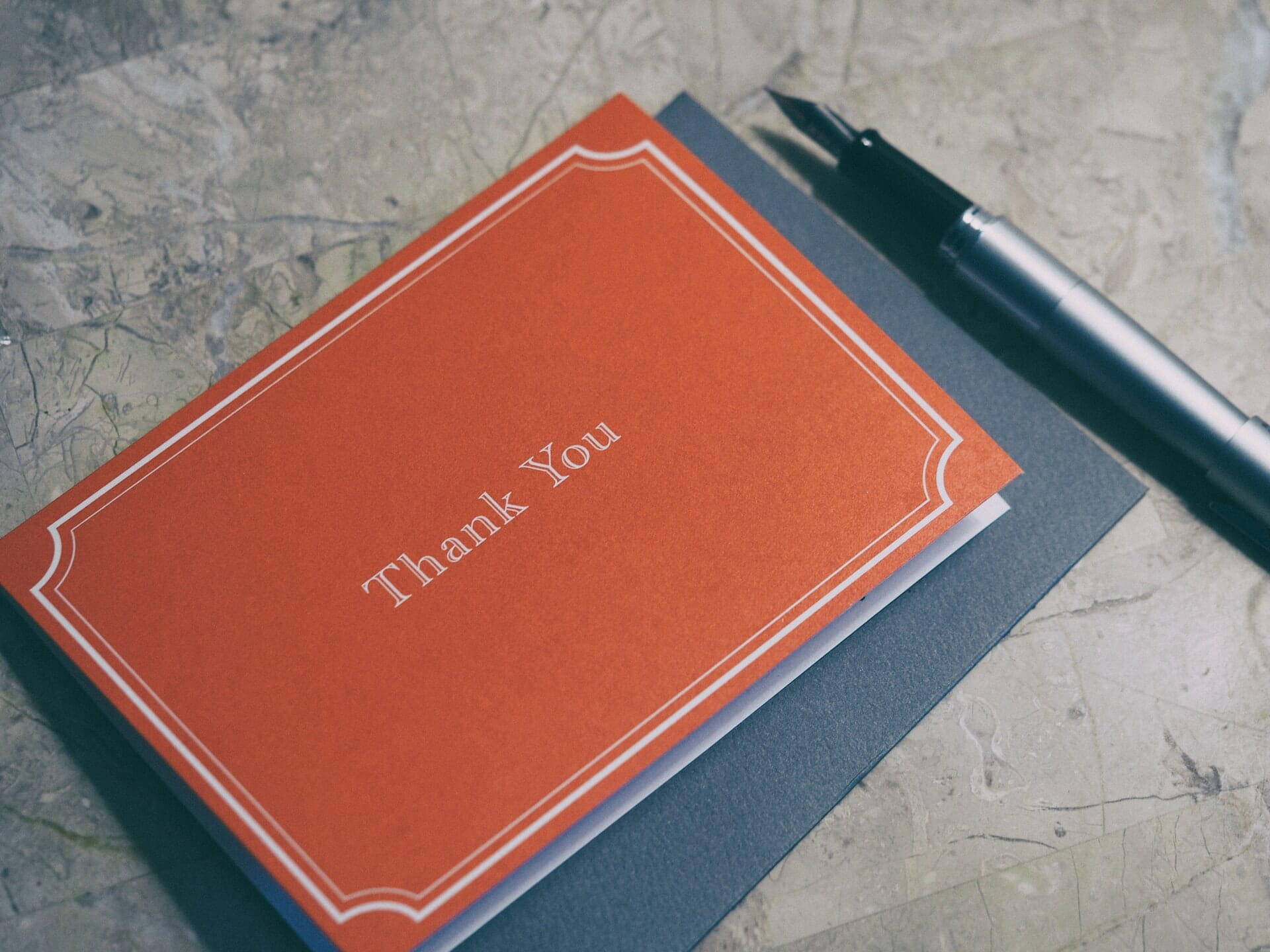 Thank you card, envelope and pen.