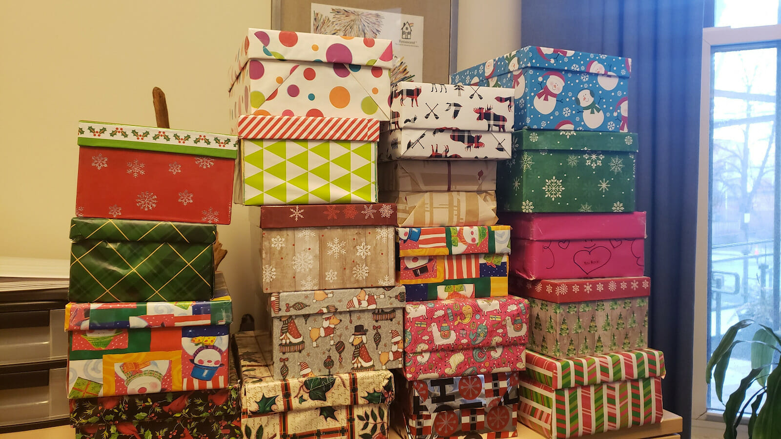 Presents wrapped and stacked up.