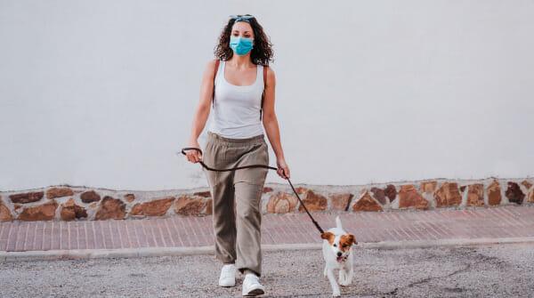 Women walking dog.